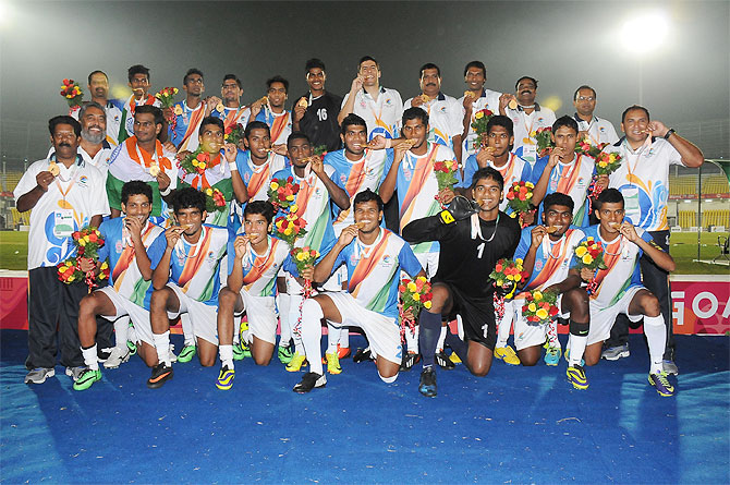The Goa (india) football team pose with their gold medals after winning the Lusofonia Games final against Mozambique on Tuesday