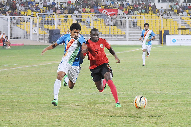 Goa (India's) Myron Fernandes and Mozambique's Osvaldo Sunde vie for possession