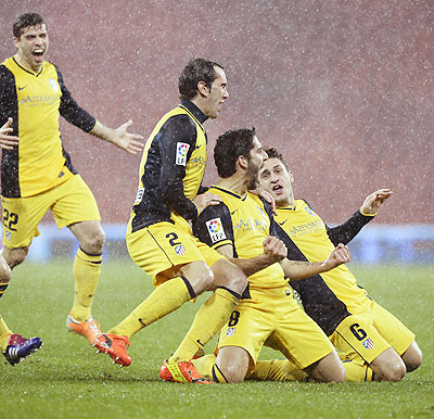Atletico Madrid players celebrate a goal during their Spanish King's Cup match against Athletic Bilbao at San Mames stadium in Bilbao