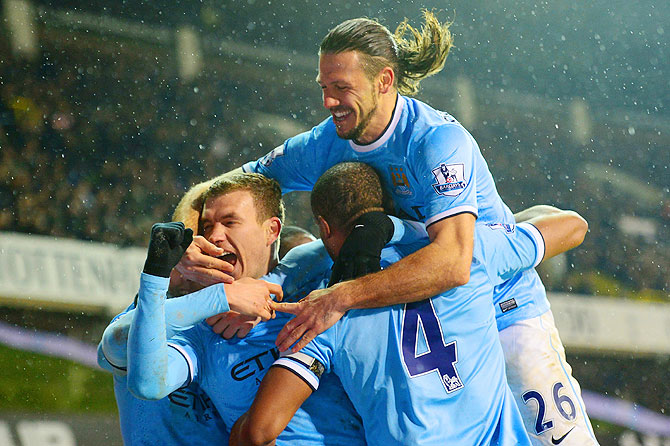 Edin Dzeko of Manchester City (centre) celebrates scoring with teammates during their English Premier League match against Tottenham Hotspur at White Hart Lane in London on Wednesday