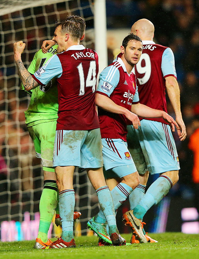Goalkeeper Adrian of West Ham celebrates with teammates after their Premier League match against Chelsea at Stamford Bridge on Wednesday