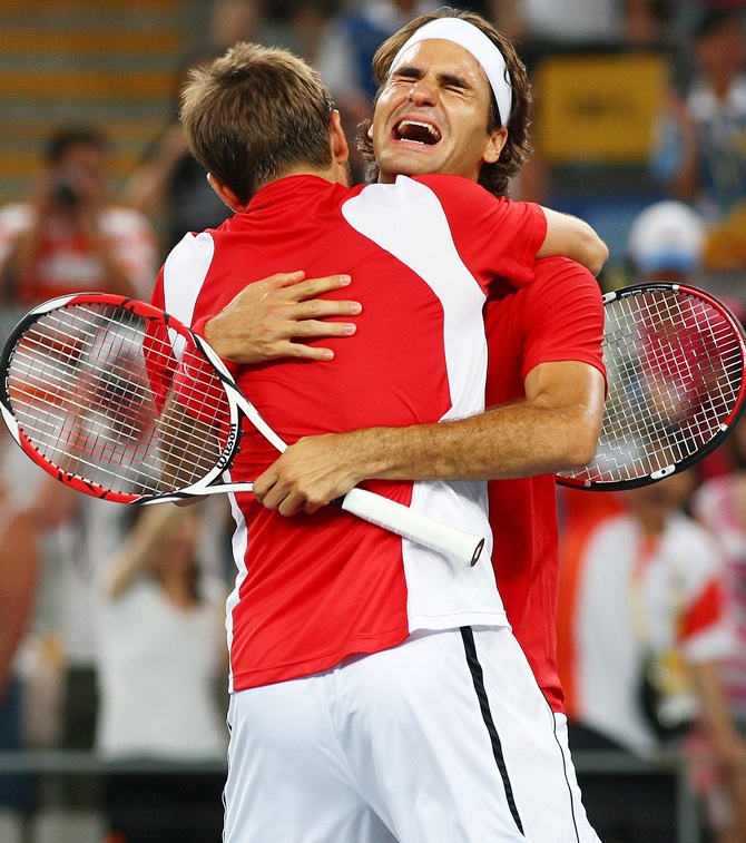 Roger Federer (right) and Stanislas Wawrinka of Switzerland celebrate