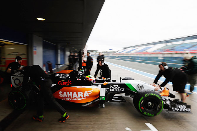 Sergio Perez of Mexico and Force India is pushed back into his team garage during day two of Formula One Winter Testing at the Circuito de Jerez in Jerez de la Frontera, Spain on Wednesday
