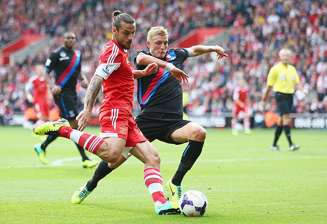 Dani Osvaldo of Southampton (left) battles for the ball with Dean Moxey of Crystal Palace