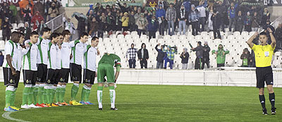 The referee blows his whistle to stop the match as Racing Santander players refuse to play at the start of their King's Cup quarter-final second leg match against Real Sociedad in Santander, on Thursday