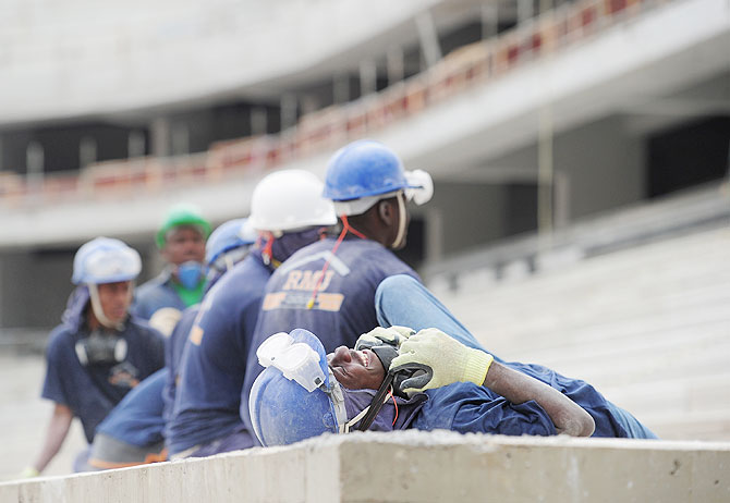 Workers from Haiti take a break at the Arena da Baixada