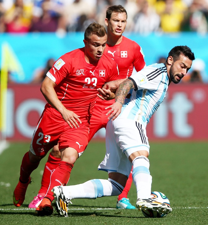 Ezequiel Lavezzi of Argentina is challenged by Xherdan Shaqiri of Switzerland