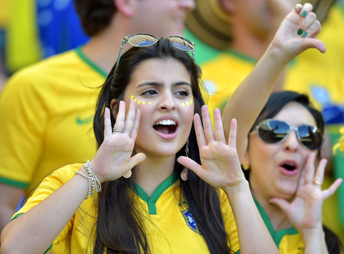 A Brazil fan enjoys the atmosphere at Estadio Mineirao in Belo Horizonte