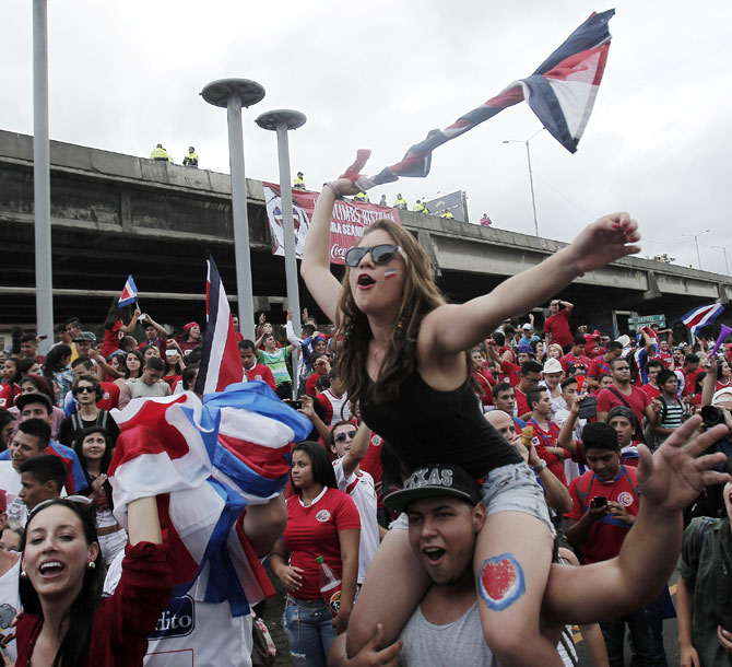 Costa Rican fans celebrate their team defeat of Greece in their round of 16 match, in San Jose