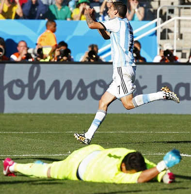 Argentina's Angel Di Maria celebrates scoring against Switzerland during extra -time in the 2014 World Cup Round of 16 game at the Corinthians arena in Sao Paulo.