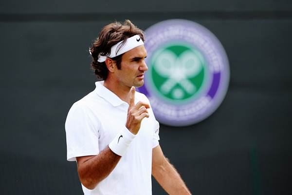 Roger Federer of Switzerland during his fourth round match against Tommy Robredo of Spain
