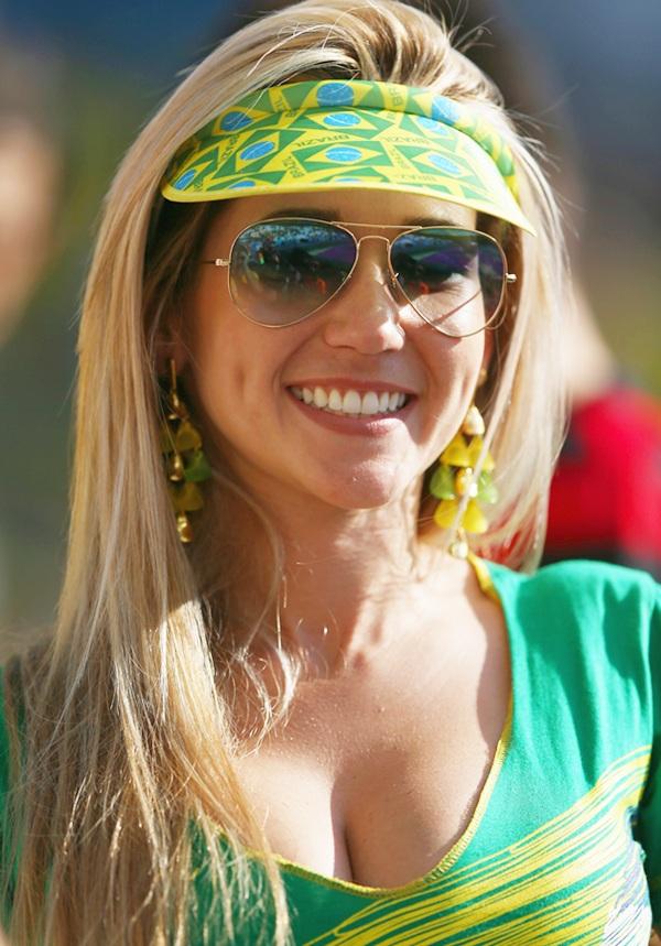 A Brazil fan poses