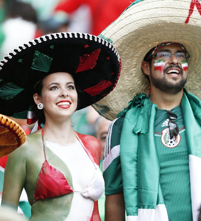 Fans of Mexico wait for the start of the match against Brazil
