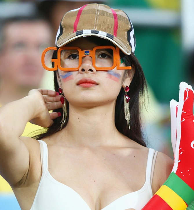 A fan looks on during the 2014 FIFA World Cup
