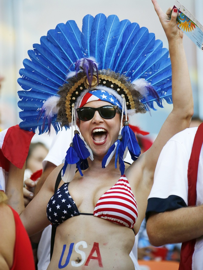 A US fan cheers during the match between Portugal and United States