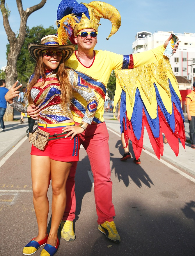Colombian fans show their colours ahead of the match between Colombia and Uruguay