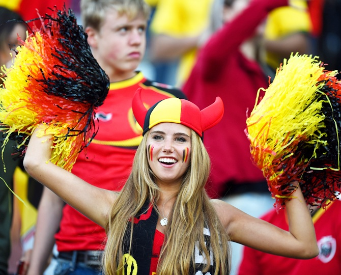 A Belgium fan cheers during the match between South Korea and Belgium