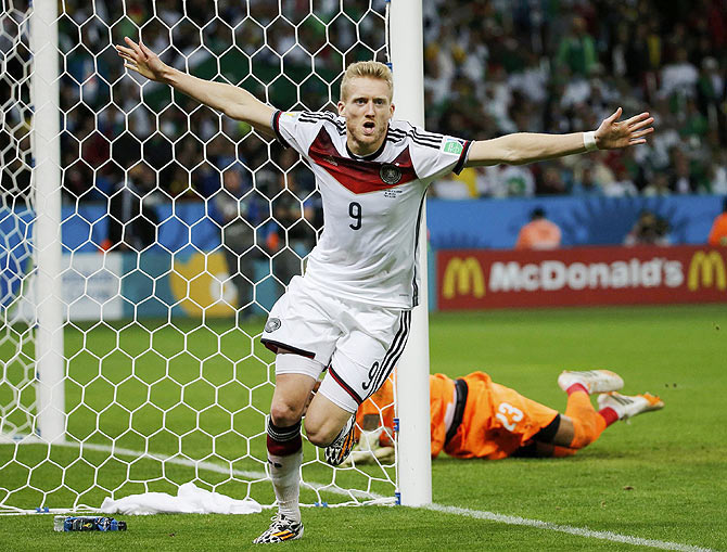 Germany's Andre Schuerrle celebrates his goal against Algeria during extra time in their 2014 World Cup round of 16 game at the Beira Rio stadium in Porto Alegre on Monday