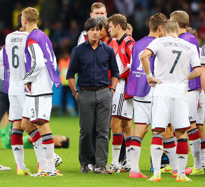 Head coach Joachim Loew of Germany looks on with his players in extra time on Monday