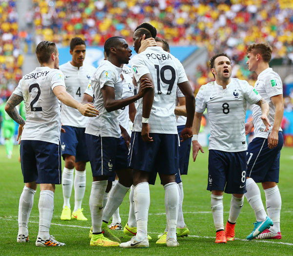 Paul Pogba of France celebrates with teammates after scoring his team's first goal against Nigeria