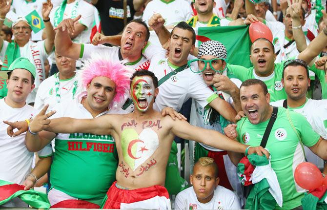 Algeria fans cheer at Arena da Baixada in Curitiba, Brazil
