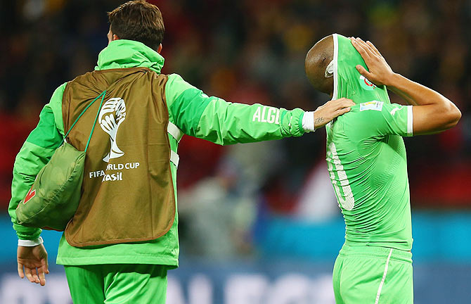 Sofiane Feghouli of Algeria (right) reacts after their defeat by Germany 2-1 during the 2014 FIFA World Cup Brazil Round of 16 match on Monday