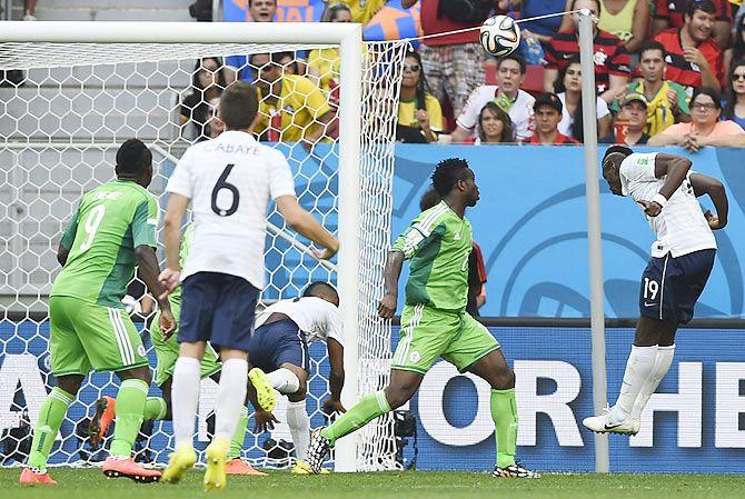 France's Paul Pogba heads the ball to score a goal against Nigeria during their 2014 World Cup round of 16 game at the Brasilia national stadium in Brasilia on Monday