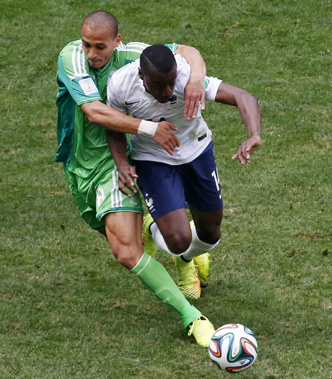 Nigeria's Peter Odemwingie (left) fights for the ball with France's Blaise Matuidi during their 2014 World Cup round of 16 game on Monday