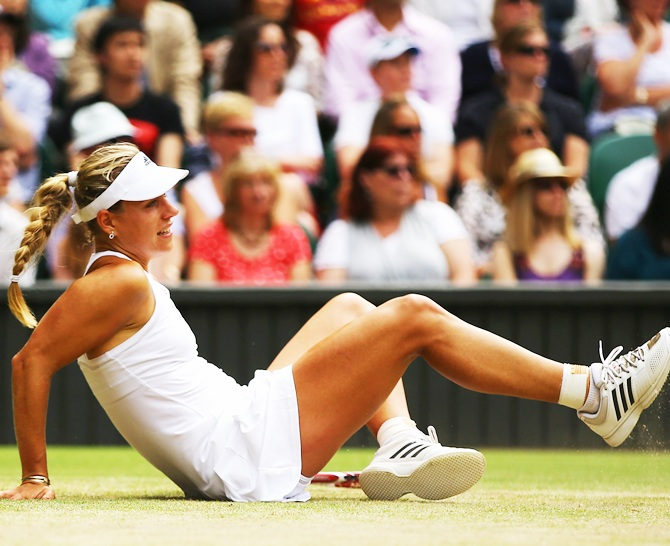 Angelique Kerber of Germany slips over during her fourth round match against Maria Sharapova of Russia