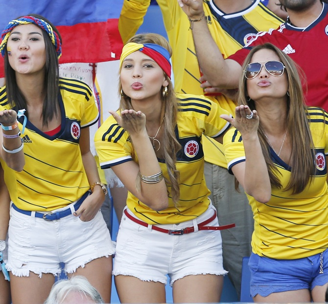 Colombia fans blow kisses