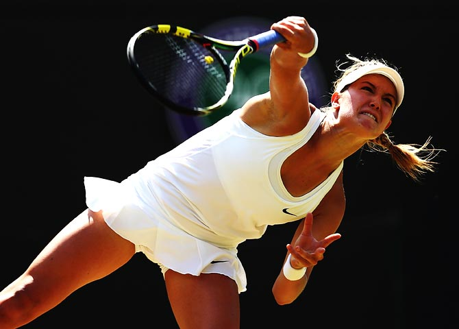 Eugenie Bouchard serves