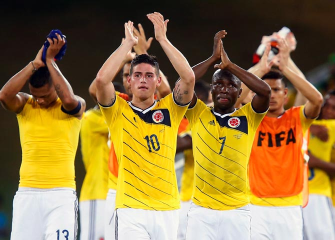 Colombia's players acknowledge the fans after their victory