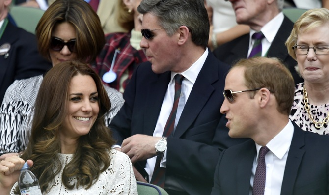 Britain's Prince William, right, and his wife Catherine