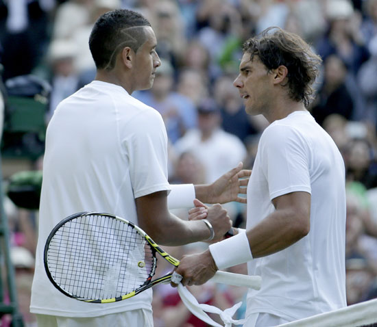 Nick Kyrgios of Australia (left) shakes hands with Rafael Nadal of Spain after defeating him