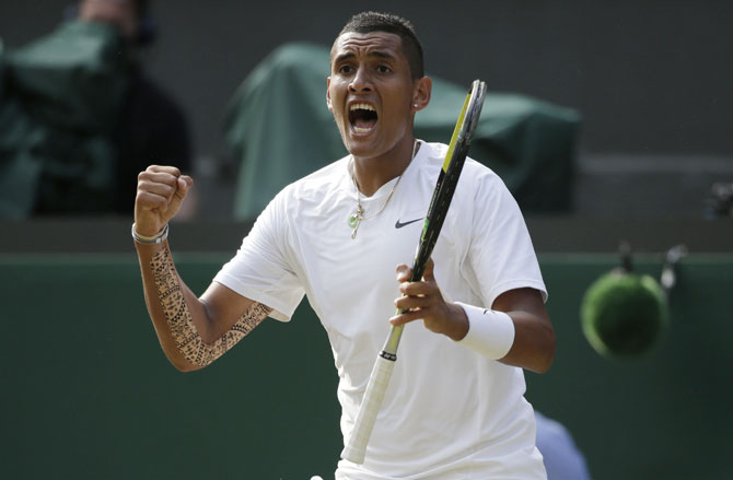 Nick Kyrgios of Australia reacts during his men's singles match against Rafael Nadal of Spain at the Wimbledon