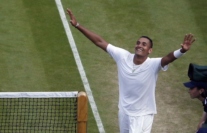 Nick Kyrgios of Australia reacts to defeating Rafael Nadal of Spain at Wimbledon