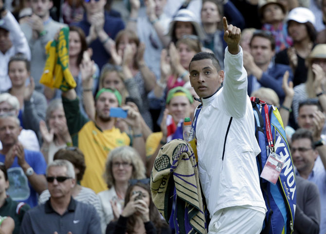 Nick Kyrgios of Australia waves after defeating Rafael Nadal of Spain