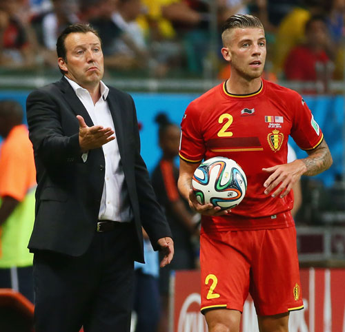 Head coach Marc Wilmots and Toby Alderweireld of Belgium look on