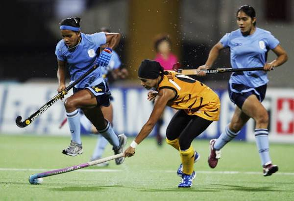 Ritu Rani (right) during a match against Malaysia