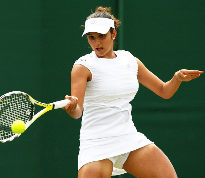 Sania Mirza plays a forehand