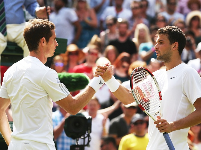 Andy Murray of Great Britain shakes hands with Grigor Dimitrov of Bulgaria after their Gentlemen's Singles quarter-final match