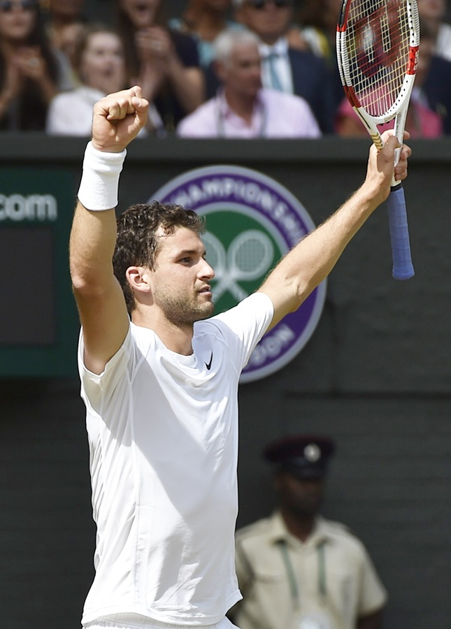 Grigor Dimitrov of Bulgaria reacts after defeating Andy Murray of Britain