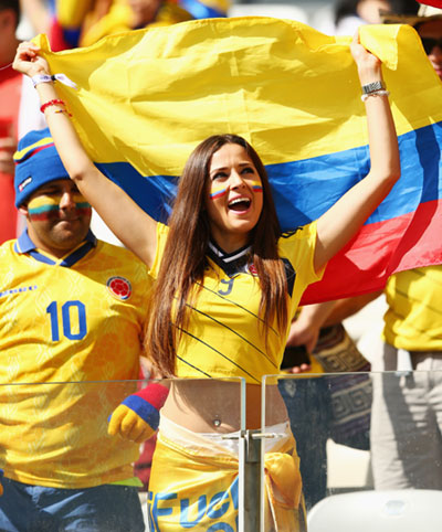 A Colombia fan cheers during the World Cup match against Japan in Cuiaba