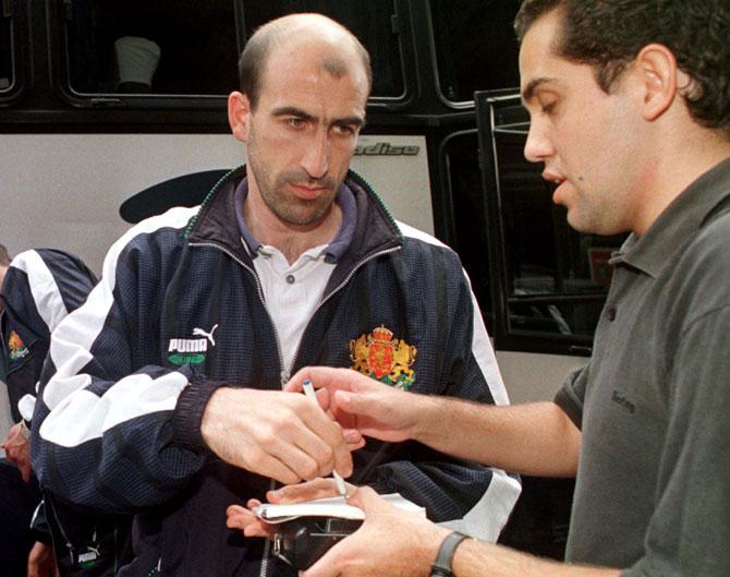 Bulgarian midfielder Yordan Lechkov signs an autograph