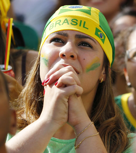 A Brazil fan reacts at a fan zone in Recife