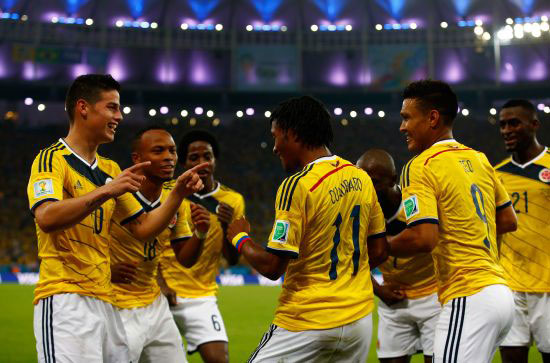 James Rodriguez of Colombia, left, celebrates after scoring with his teammates
