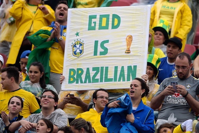 Brazilian fans cheer their team
