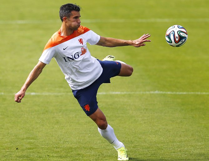 Netherlands' captain Robin van Persie kicks the ball during a training session in Rio de Janeiro