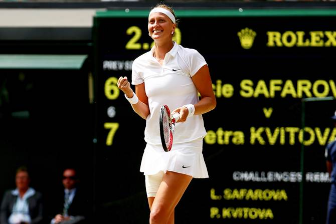 Petra Kvitova of Czech Republic celebrates after beating compatriot Lucie Safarova in the women's singles semi-finals at Wimbledon