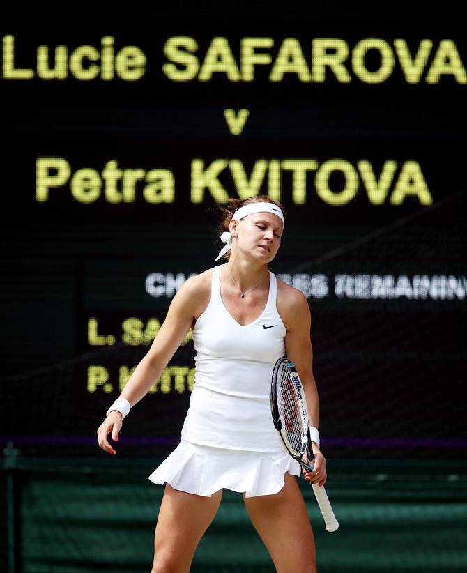 Lucie Safarova of Czech Republic stands dejected after losing to Petra Kvitova